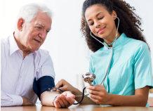 woman checking up an elderly man