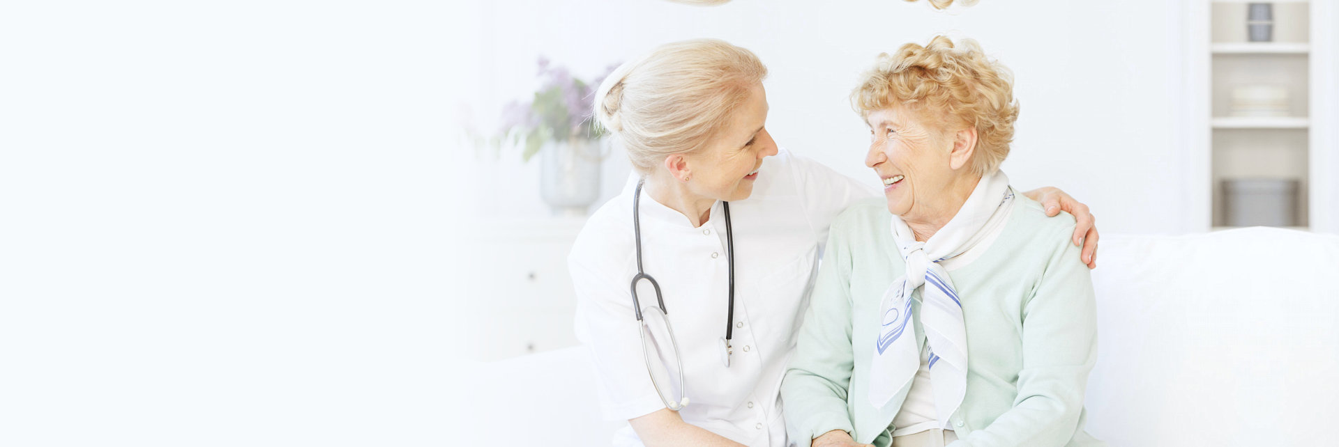 woman and elderly woman smiling